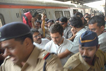 Rahul Gandhi alights from a local train in Mumbai