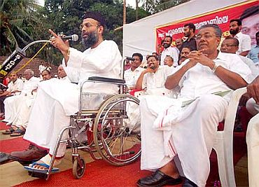 File photo shows Madani sharing the dais with Communist leader Pinarayi Vijayan