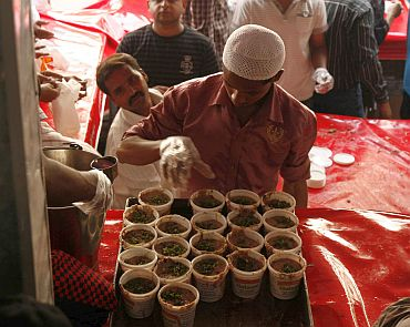 A shop employee readies the Haleem for sale