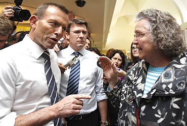 Australian Opposition leader Tony Abbott speaks to a shopper at a Melbourne shopping centre