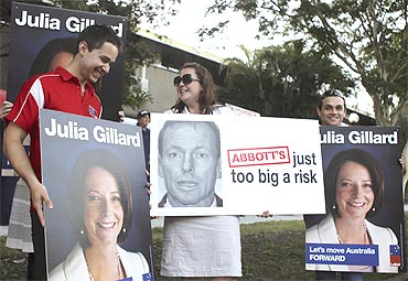 Placards of Prime Minister Julia Gillard and Tony Abbott in Brisbane