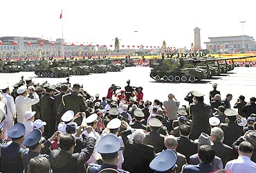 People's Liberation Army tanks roll pass Tiananmen Square in Beijing