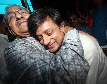 Tharoor hugs his father-in-law Colonel P N Das