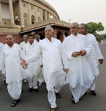 RJD chief Lalu Prasad Yadav, who held a mock Parliament over the pay issue, leaves the premises along with other MPs