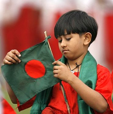 A Bangladeshi kid waves the national flag