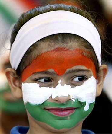 The Indian flag is painted on a girl's face during an India-Sri Lanka cricket match in Dambulla