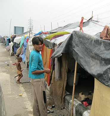 Babu Rao, a slum dweller, shows his current abode