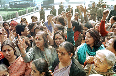 Women activists shout slogans during a protest outside Parliament demanding introduction of the women's reservation bill