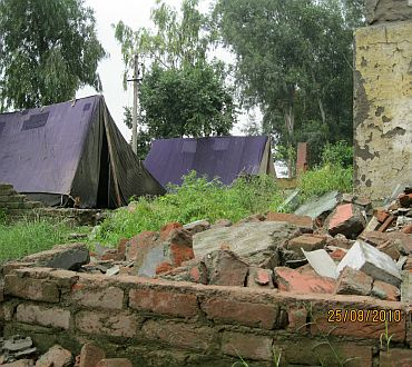 Police camps at the bulldozed slum location