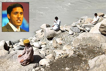 Three men pray by the banks of the Swat River and (inset) Rajiv Shah