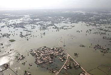 An aerial view shows a flooded village in Rajanpur district of Pakistan's Punjab province