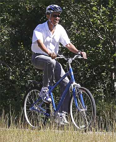 US President Barack Obama rides along a bike path in Martha's Vineyard