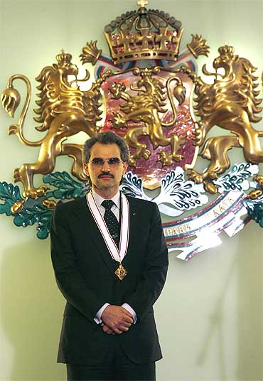 Saudi Prince Al-Waleed bin Talal stands after being awarded the 'Stara Planina' medal by Bulgaria's President Georgi Parvanov in Sofia