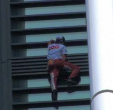 Video grabs show Robert climbing the Sydney skyscraper