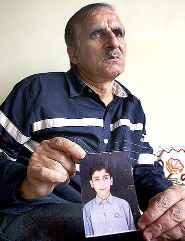 Mohammed Ashraf Mattoo with his son Tufail's photograph