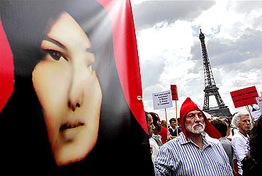 Protestors demonstrate against the death-by-stoning sentence of Iranian woman Sakineh Mohammadi Ashtiani in Paris