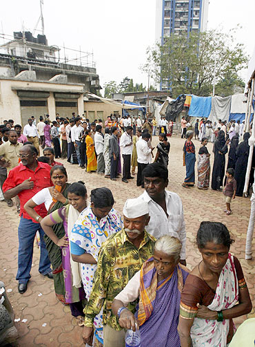 People queue to cast their votes during the Maharashtra state elections in Mumbai in October 2009