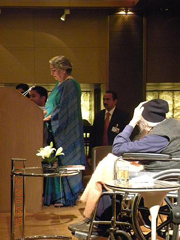 Gursharan Kaur speaks at the event as Khushwant Singh looks on