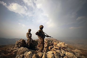 Pakistani soldiers keep guard on top of Kund mountain near Kotkai village in South Waziristan