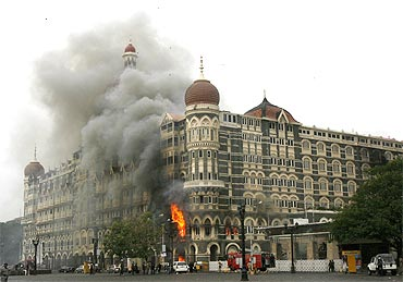 The Taj Mahal hotel in Mumbai is seen engulfed in smoke during the 26/11 terror attacks