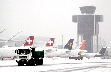 A lorry transports snow at Cointrin airport in Geneva
