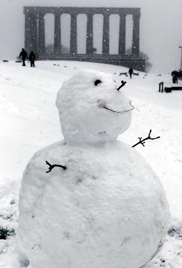 A snowman sits on Calton Hill in Edinburgh, Scotland