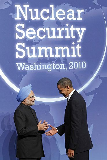PM Dr Singh talks with President Obama on arrival at th