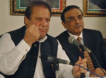 Pakistan's former PM Nawaz Sharif speaks during joint news conference with Zardari in Islamabad