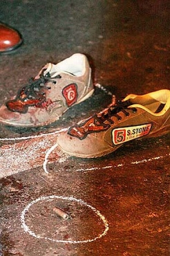 The shoes of a killed terrorist and a spent bullet during the 26/11 terror strike