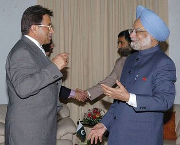 A file photo of General Pervez Musharraf with Prime Minister Manmohan Singh