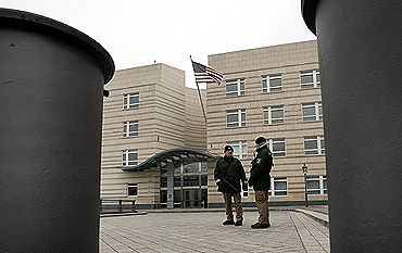 Policemen stand guard at the US embassy in Berlin