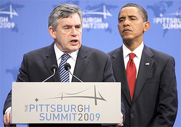 Former British PM Gordon Brown with US President Barack Obama