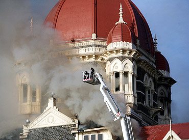 Firefighters try to douse a fire at the Taj Mahal Hotel in Mumbai during the 26/11 terror attacks