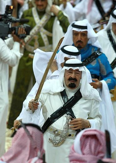 File photo shows King Abdullah taking part in a religious festival in Riyadh