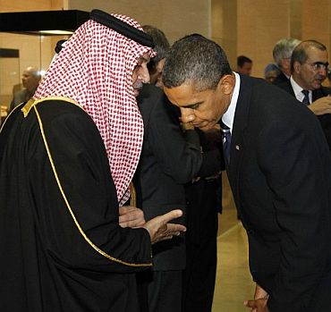 US President Barack Obama talks with Saudi Arabia's Foreign Minister Prince Saud Al-Faisal as they arrive at the National Museum of Korea for dinner in Seoul for the G20 Summit