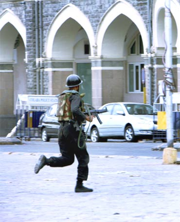 A NSG commando takes position near the Taj Hotel during the 26/11 terror attacks in Mumbai
