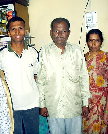 Krishnant with his parents in their Pune home