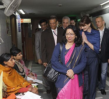 Carla smiles to patients as she visits the Safdarjung hospital