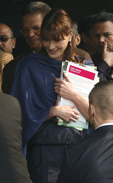 Carla departs after meeting with HIV patients