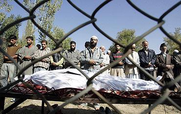 The family members of Lateef Ahmad, a Lashkar-e-Tayiba militant, pray during his funeral in Wagub, 40 km north of Srinagar