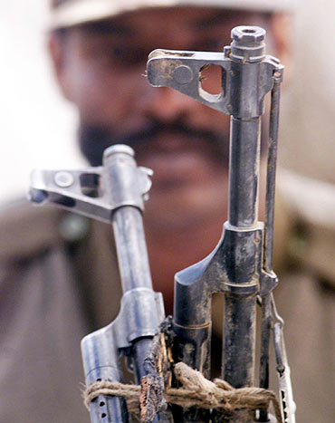 A BSF trooper during a gun battle with Lashkar militants
