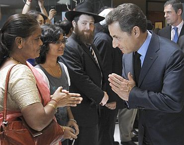 France's President Nicolas Sarkozy greets relatives of 26/11 victims