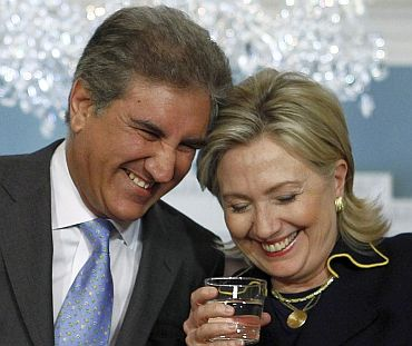 US Secretary of State Hillary Clinton shares a laugh with Pakistan Foreign Minister Shah Mehmood Qureshi