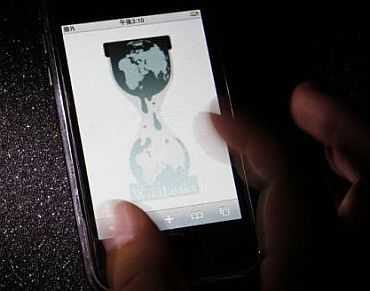 A person checks the WikiLeaks site on his mobile phone