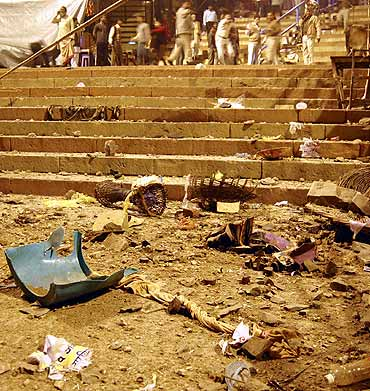 Onlookers stand at the site of a blast in Varanasi on Tuesday.