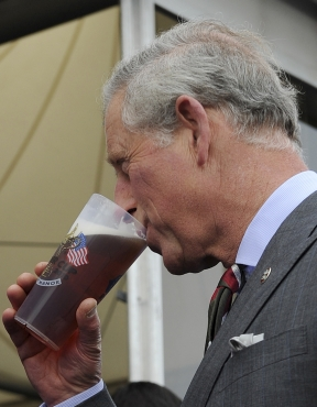 Britain's Prince Charles tastes a pint of beer
