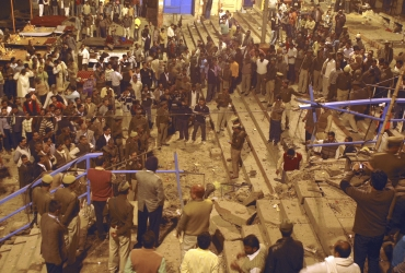 Onlookers at the site of the blast in Varanasi on December 7, 2010