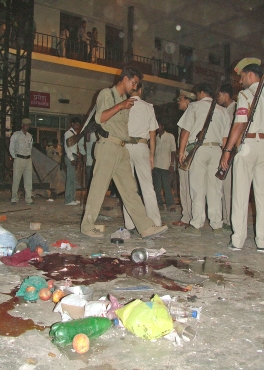 Police inspect the site of a bomb blast in Varanasi on March 7, 2006