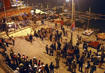 Onlookers stand at the site of a blast in Varanasi