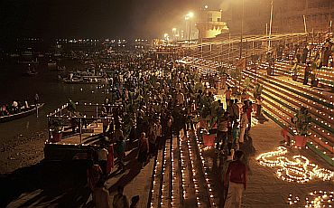 Devotees gather to offer prayers on the banks of Ganga in Varanasi to celebrate Diwali